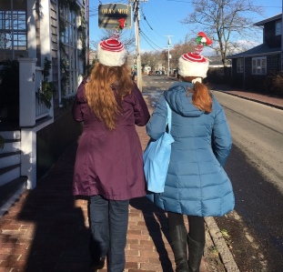 Two Girls Wearing Christmas Hats