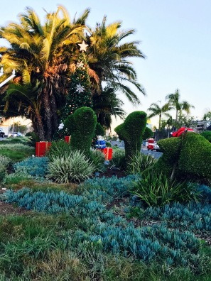 Image of topiary in the shape of dolphins at Christmas