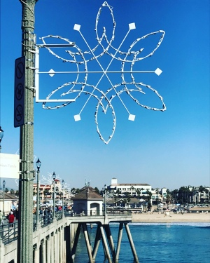 Image of a snowflake light on the Huntington Beach Pier