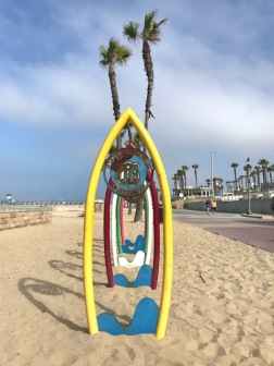 Image of surfboard art at the beach.