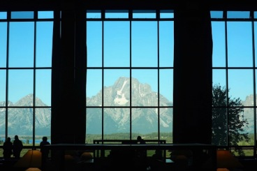 Image of mountains in window of lodge.