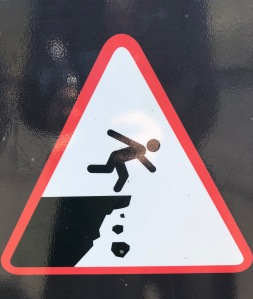 Image of someone falling off a cliff.