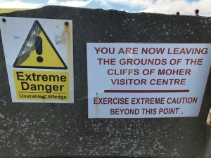 Image of a sign that says Extreme Danger, You are Now Leaving the Grounds of the Cliffs of Moher