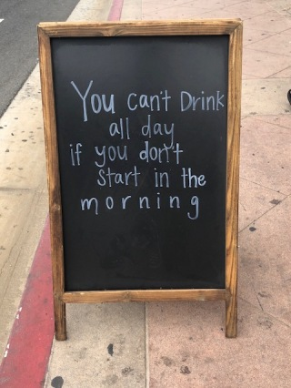 Image of sign that says You can't drink all day if you don't start in the morning.