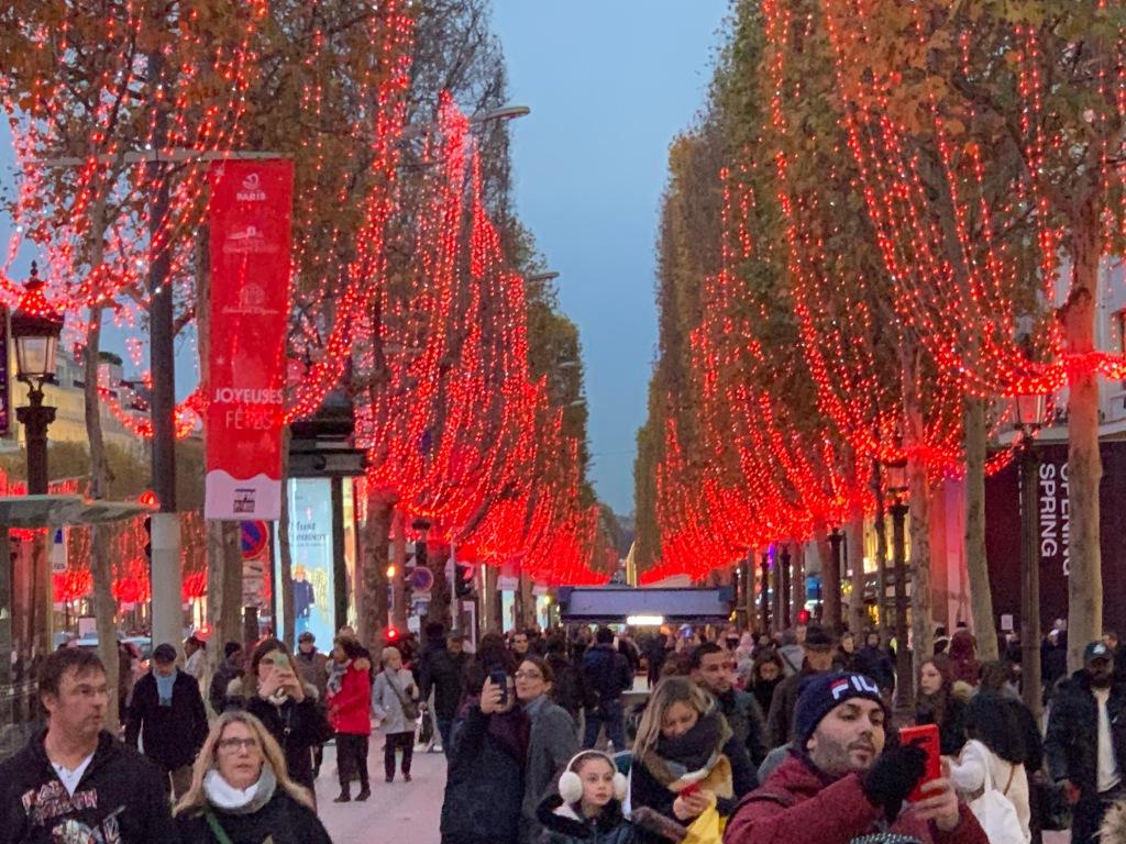 Image of the trees lit up along the Champs-Élysées.